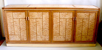 Cherry quilted maple audio video cabinet